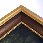 Gold frame with wood slip and then a fine beaded gold slip